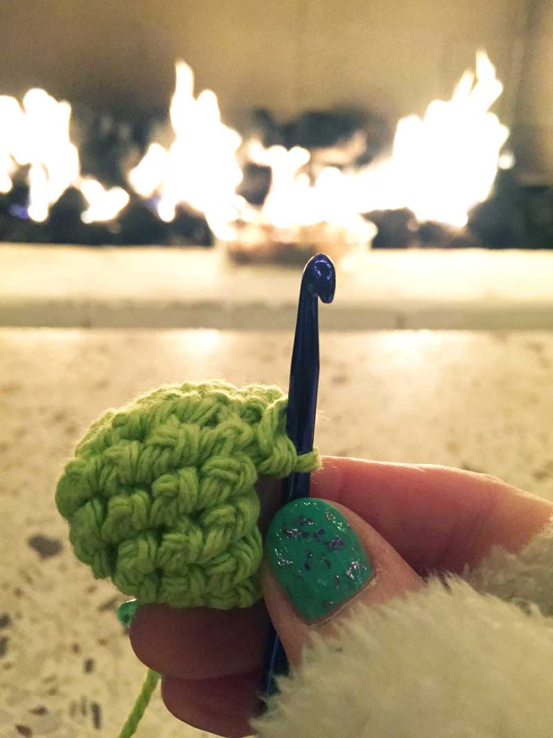 Crocheting by the fire