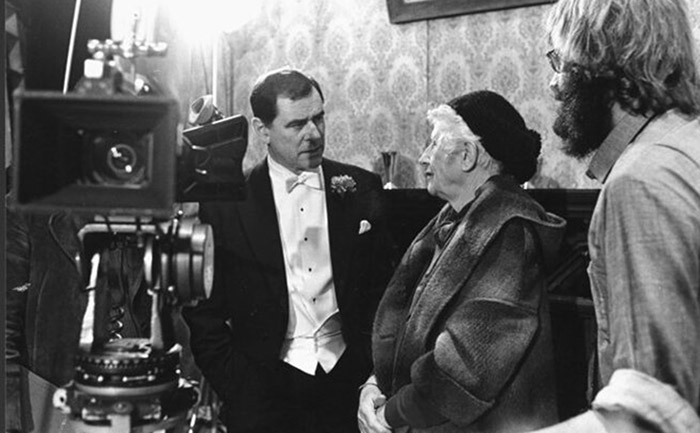 black and white photo of actor george baker and author ngaio marsh on set