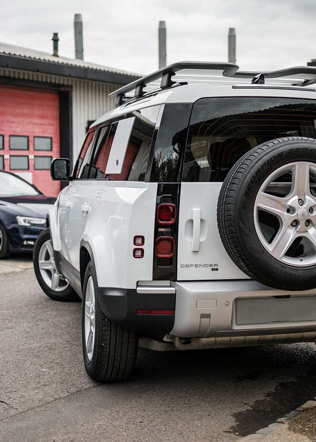 White Land Rover Defender with tinted windows after window tinting