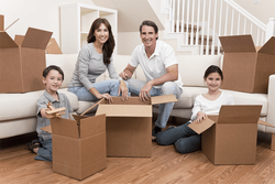 A stack of boxes and a family behind it