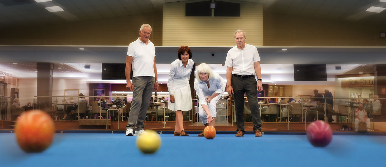 Couples playing bowls