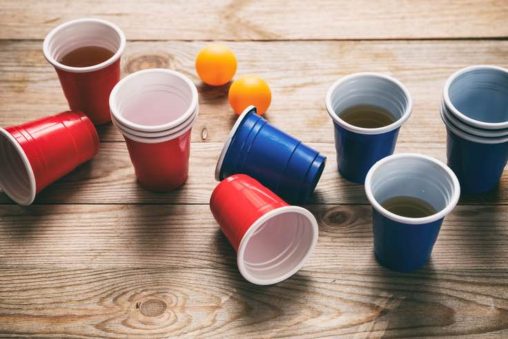 Blue and red cups, ping pong ball, beer pong