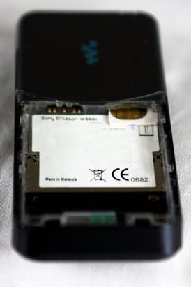 SIM card partially inserted