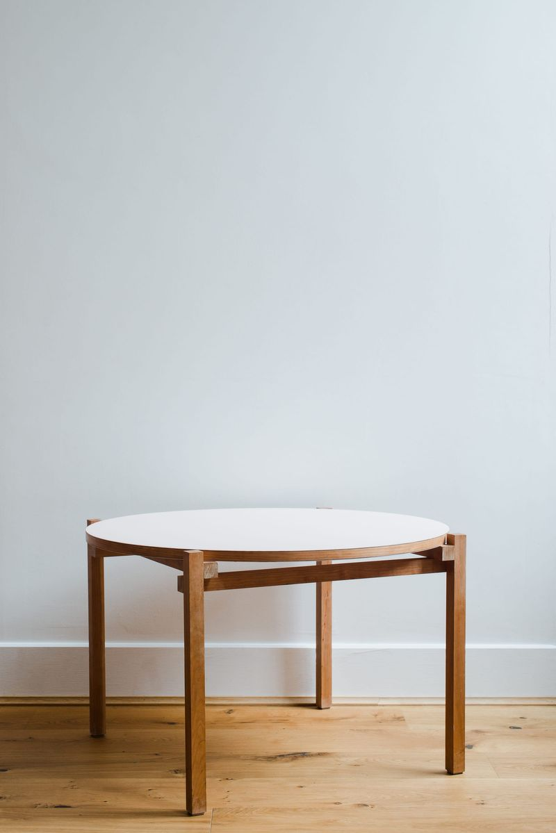 Detailed view of the bespoke solid cherry, felt and brass coffee table and furniture designed by From Works at the National Justice Museum in Nottingham.