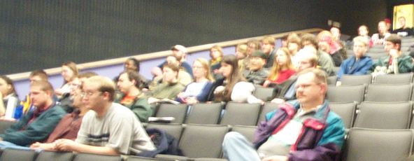 An early ANO meeting in the Bowen Thompson Student Union Theater. Many members are wearing colorful clothing.