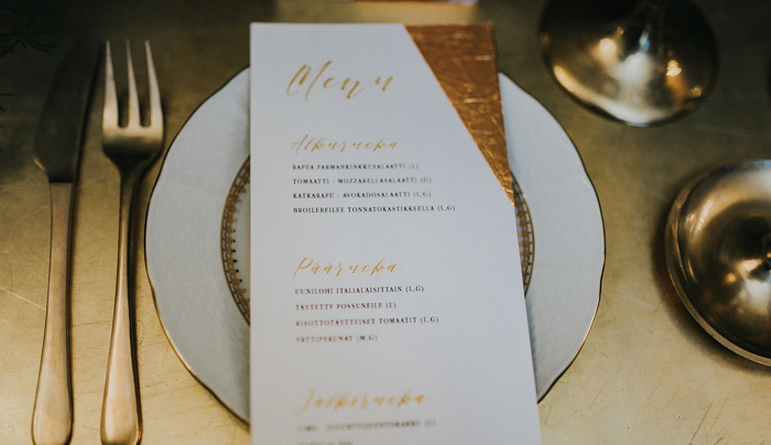 menu with hand-made golden decoration, photo by Marissa Tammisalo item thumbnail