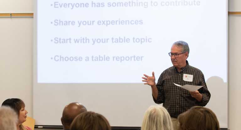 """Presentation slide """"Sharing your story about being scammed or how you avoided a scam takes away shame and helps others."""""""