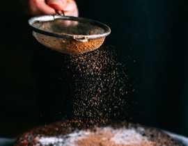 sifting cinnamon sugar