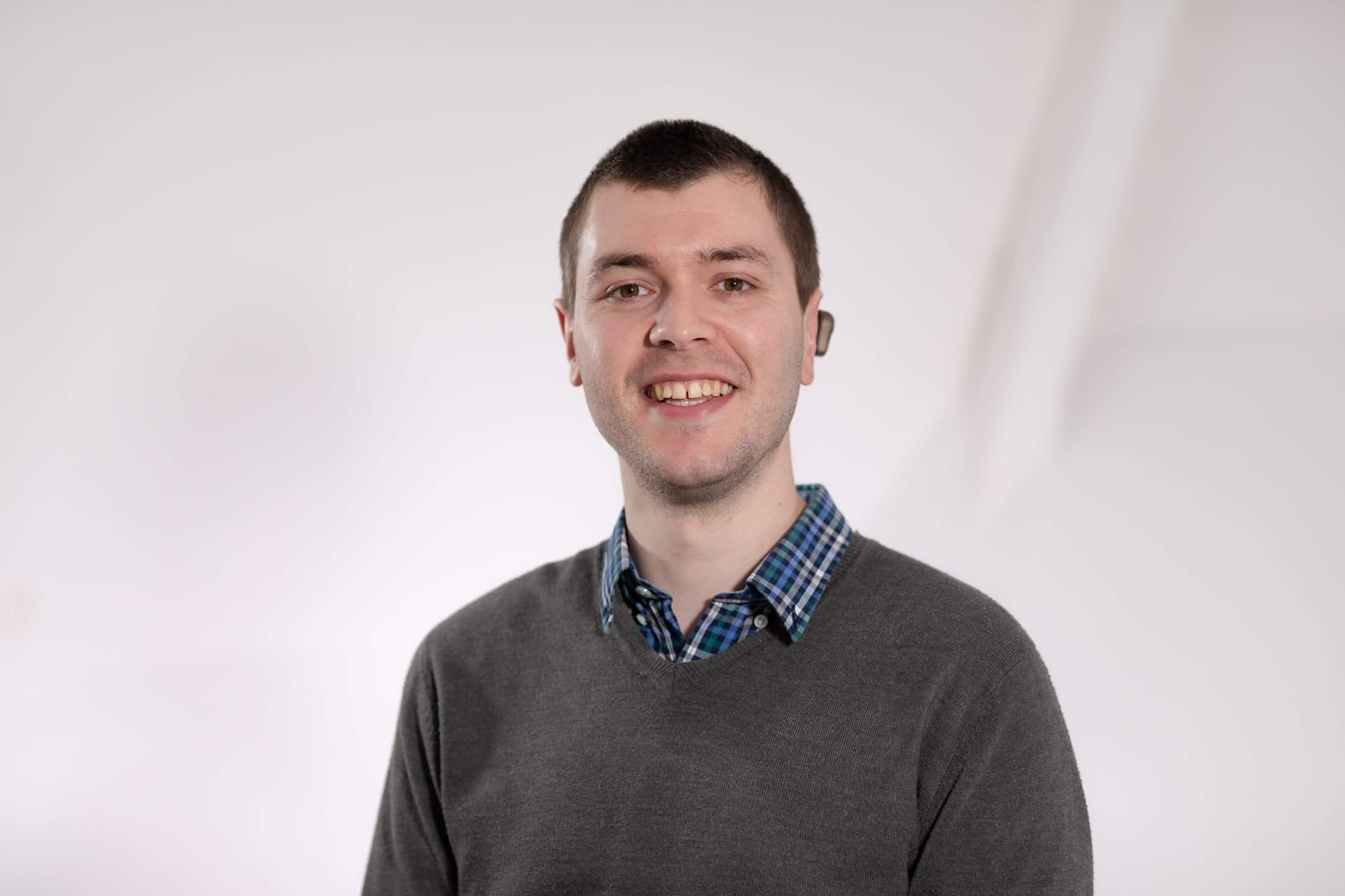A photo of Mathew Teague smiling.