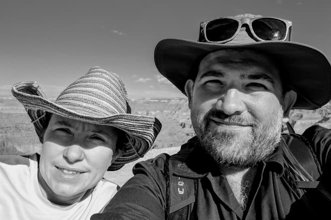 A black-and-white selfie of Len and myself, with the Grand Canyon in the distance.