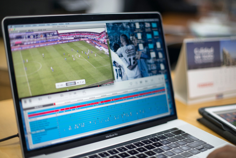 Laptop displaying soccer video analysis