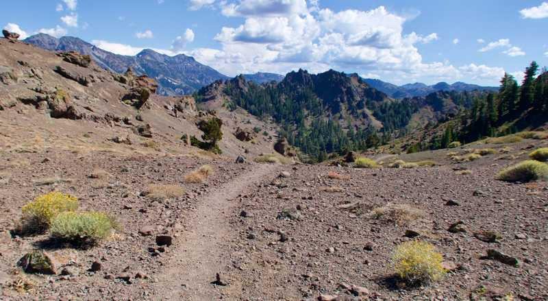 The trail crosses a gravel ridge