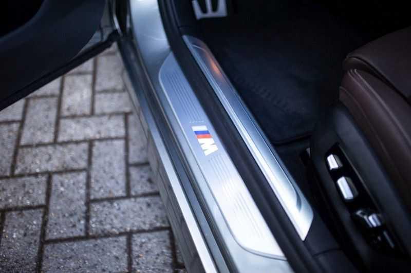 BMW 7 Serie 740d xDrive *Schuifdak / H&K / Memory / LED / ACC / Stoelventilatie* afbeelding 21
