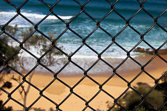 beach through the fence