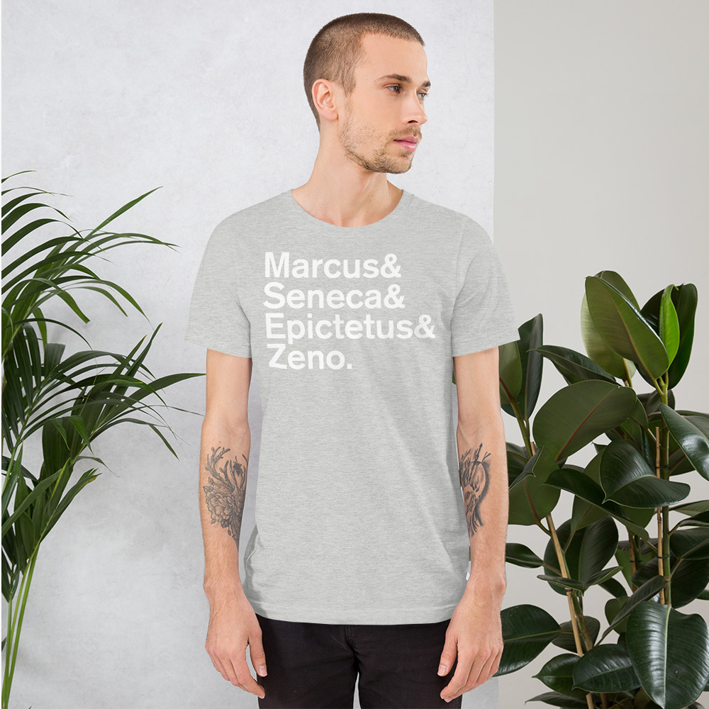 Man standing with grey tshirt with the names of famous stoic philosophers