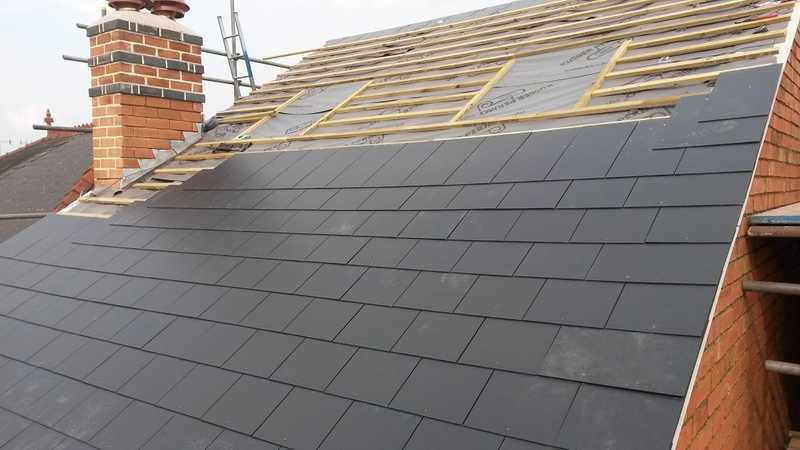 New slate tiles being installed to a client's property, on top of the felt and batten