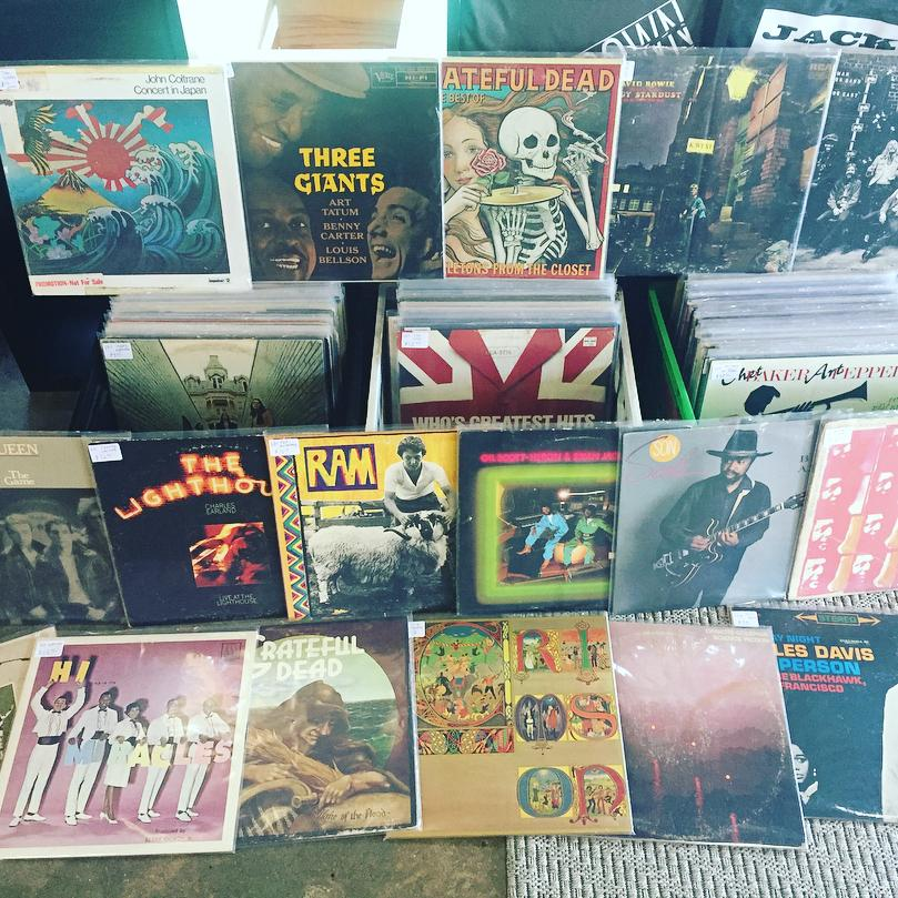 Record collection featuring jazz, rock, new wave, John Coltrane, Charles Earland, Gil Scottheron, Grateful Dead, The Who, King Crimson, & Miles Davis.