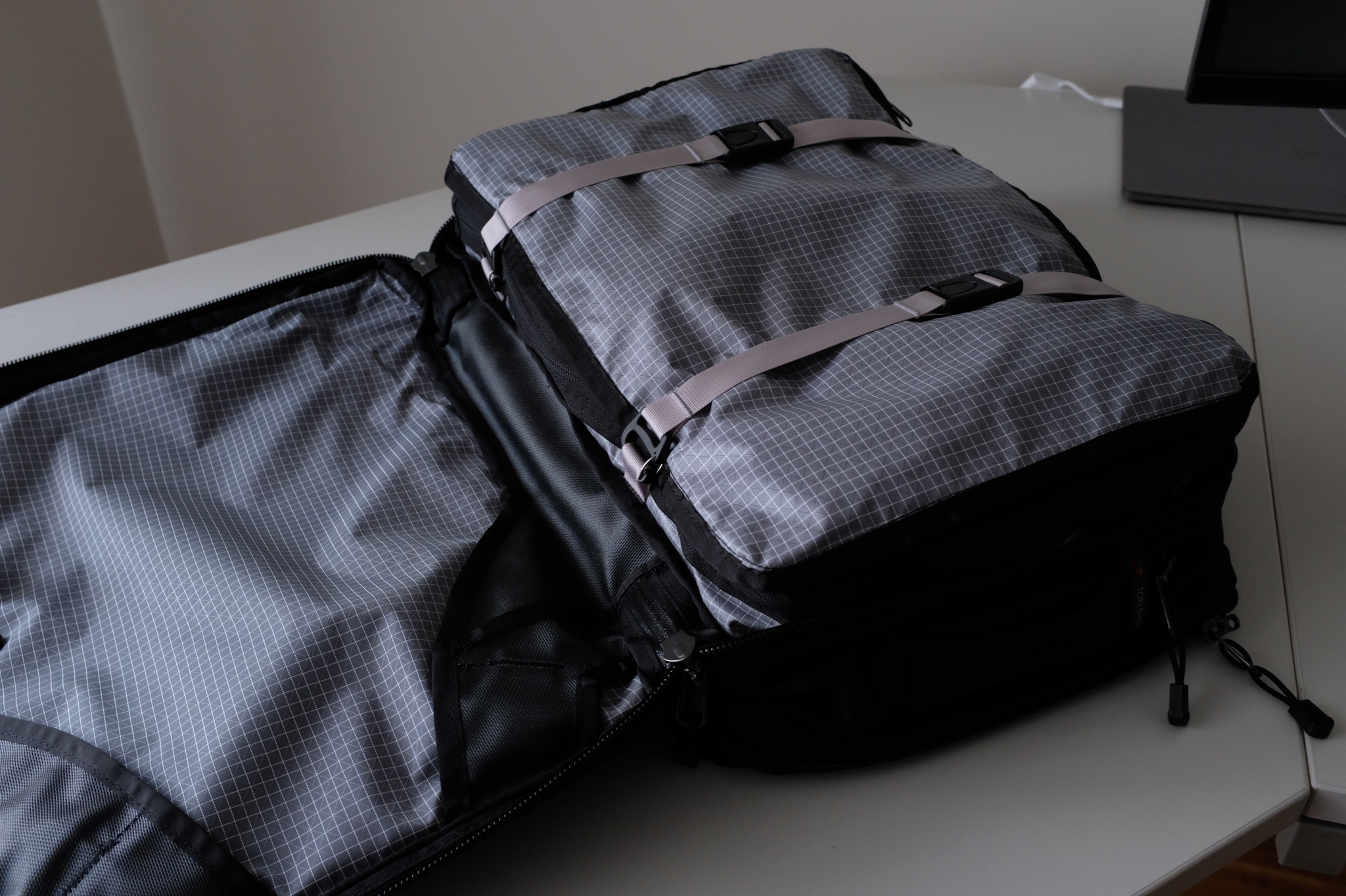The PCBP perfectly fits into the large compartment and with the compression straps you can even gain more space
