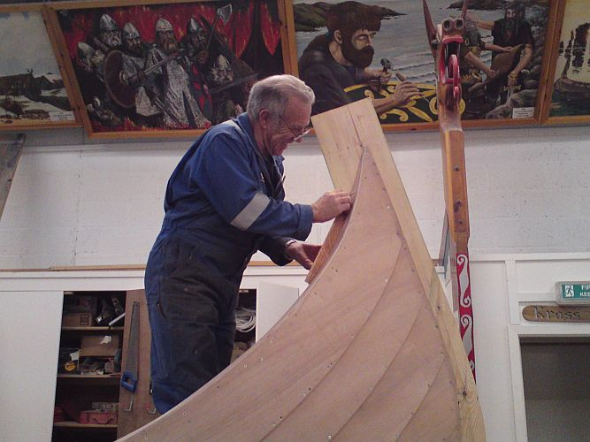 Retired boat builder, Robbie Tait, fitting the forad honeyspot