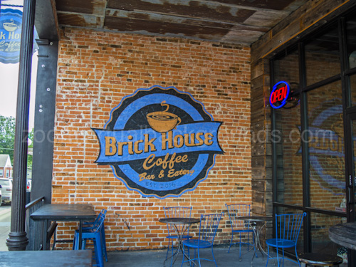 Cafe Virtual Background for Zoom outdoor tables with logo on walls brick house coffee