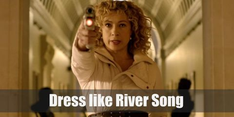 River Song has donned on many outfits during her stint in the show, from formal gowns to adventurer garbs. For this one, let's meet in the middle. She's wearing a snow white leather jacket and brown tights that makes her look like a well-styled archeologist (which she is!).