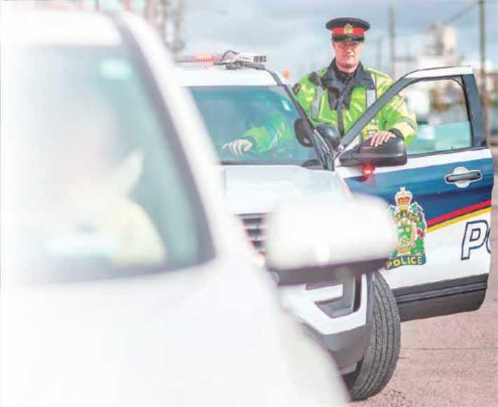 Saskatoon police officer getting into vehicle