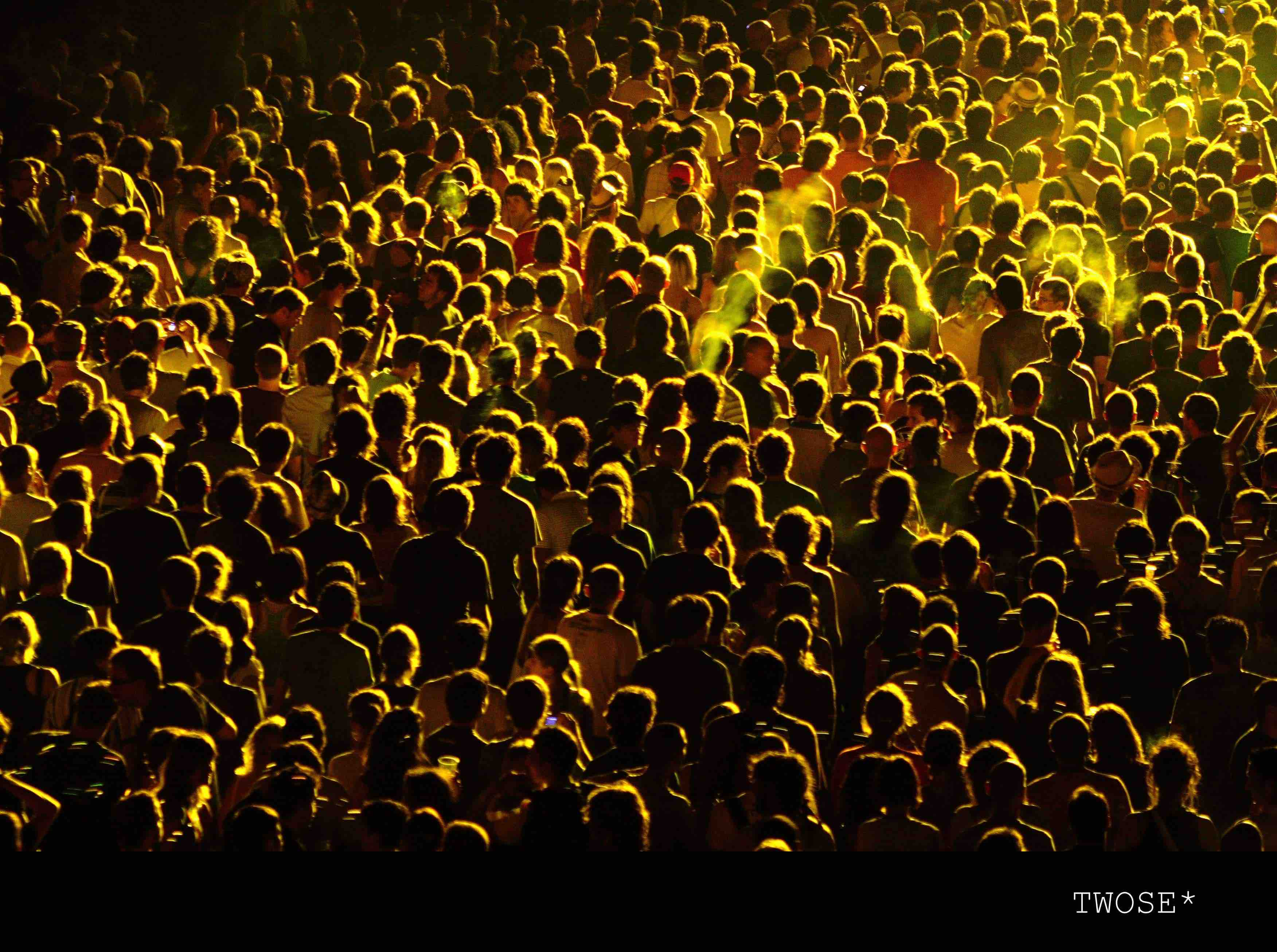 homogenous crowd with yellow light