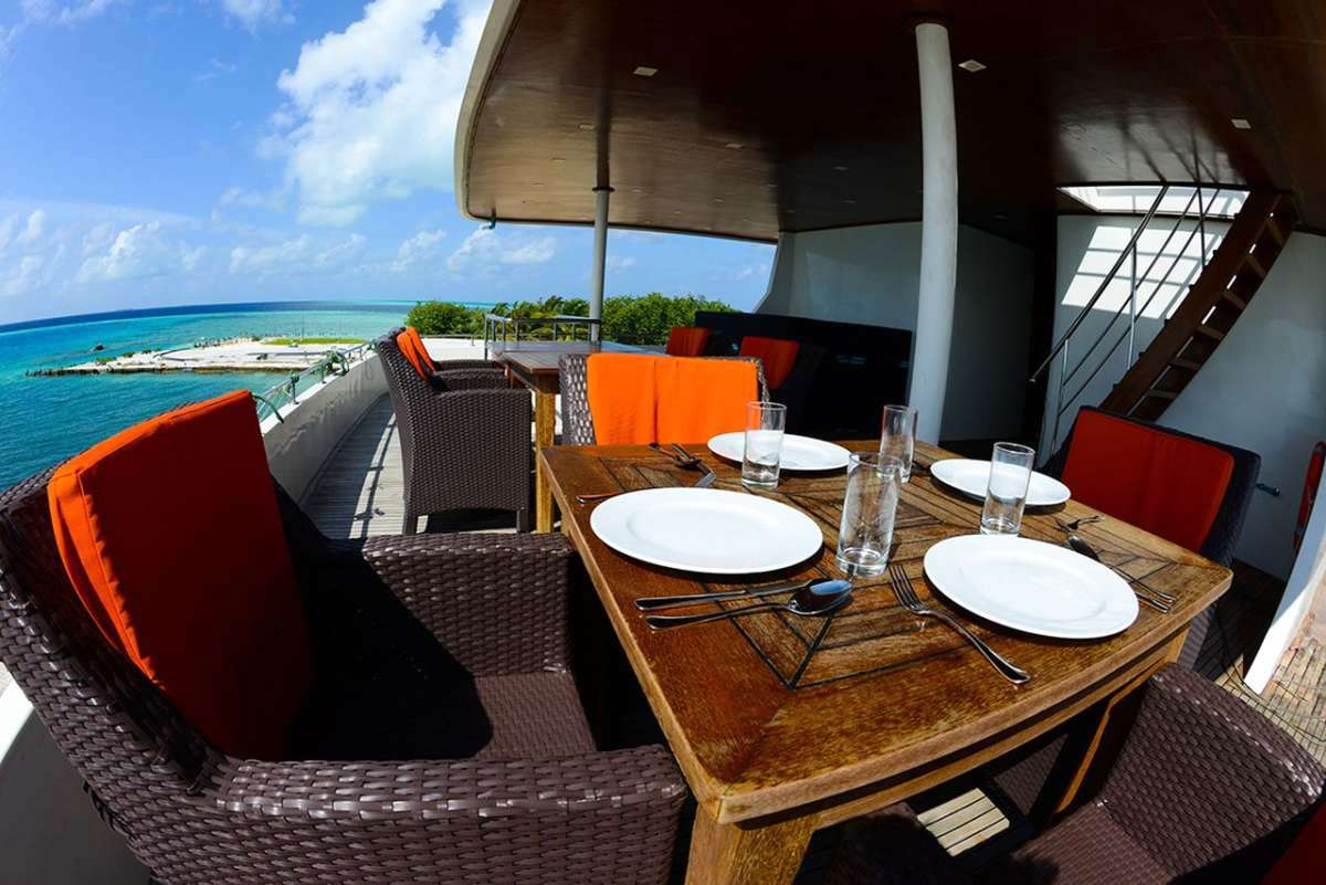 Maldives Explorer Charter Boat for surfing and diving around the atolls living areas dining