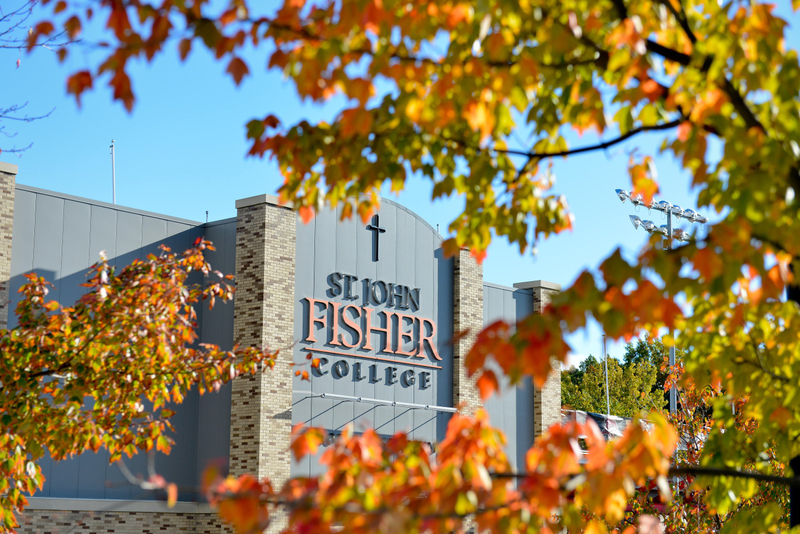 Image of St. John Fisher building with colorful leaves around it