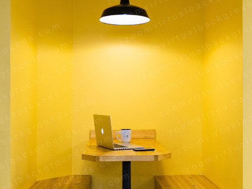 Meeting booth Virtual Background for Zoom with bright yellow wall and overhead lamp