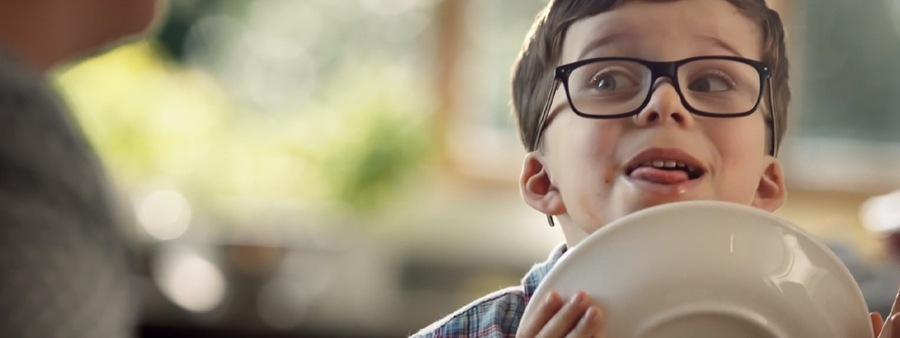 Mushroom campaign still of boy with glasses licking plate