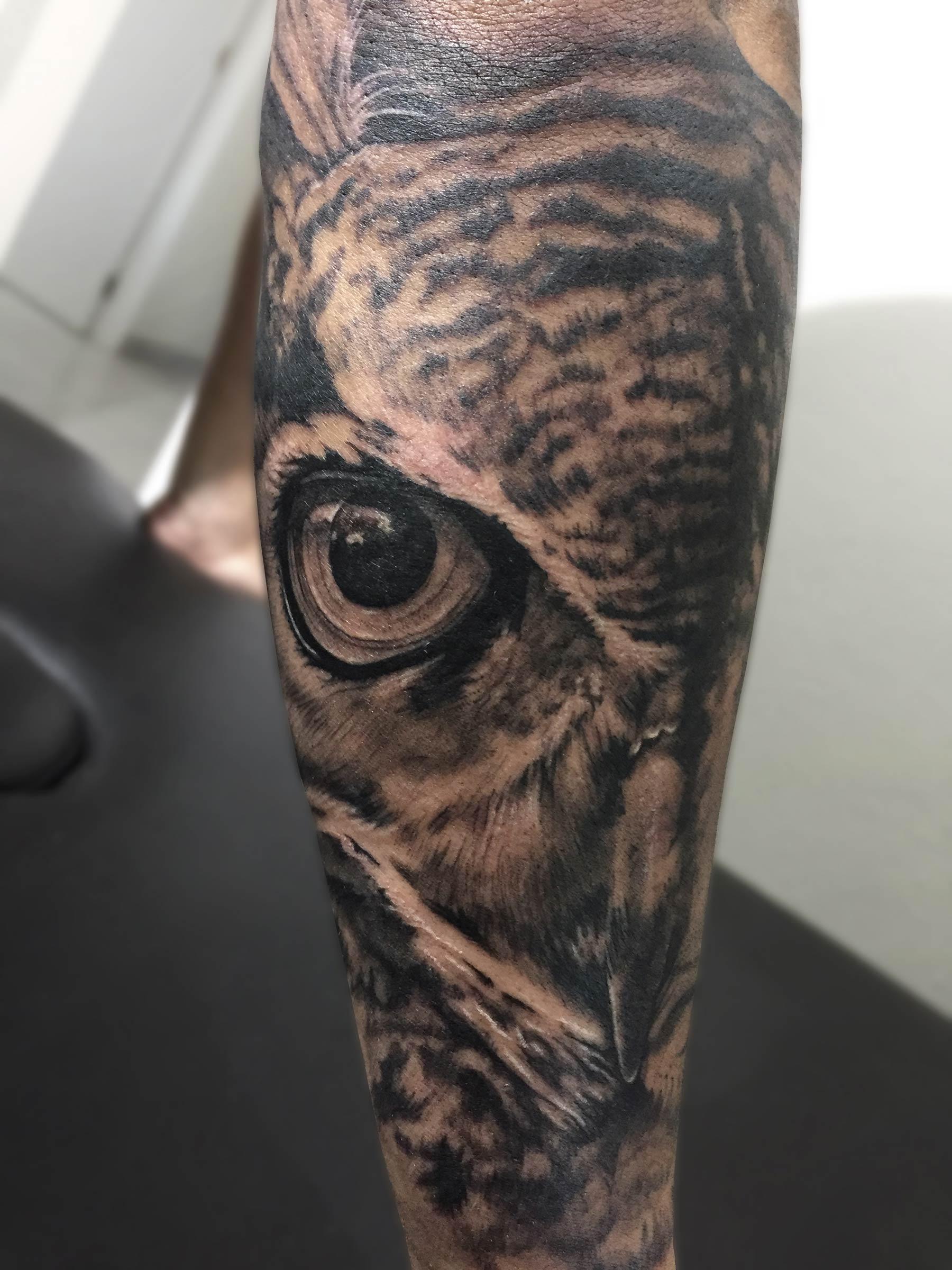 tatuaje ojo buho