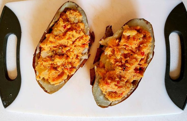 Potato skins stuffed with hummus mashed potato