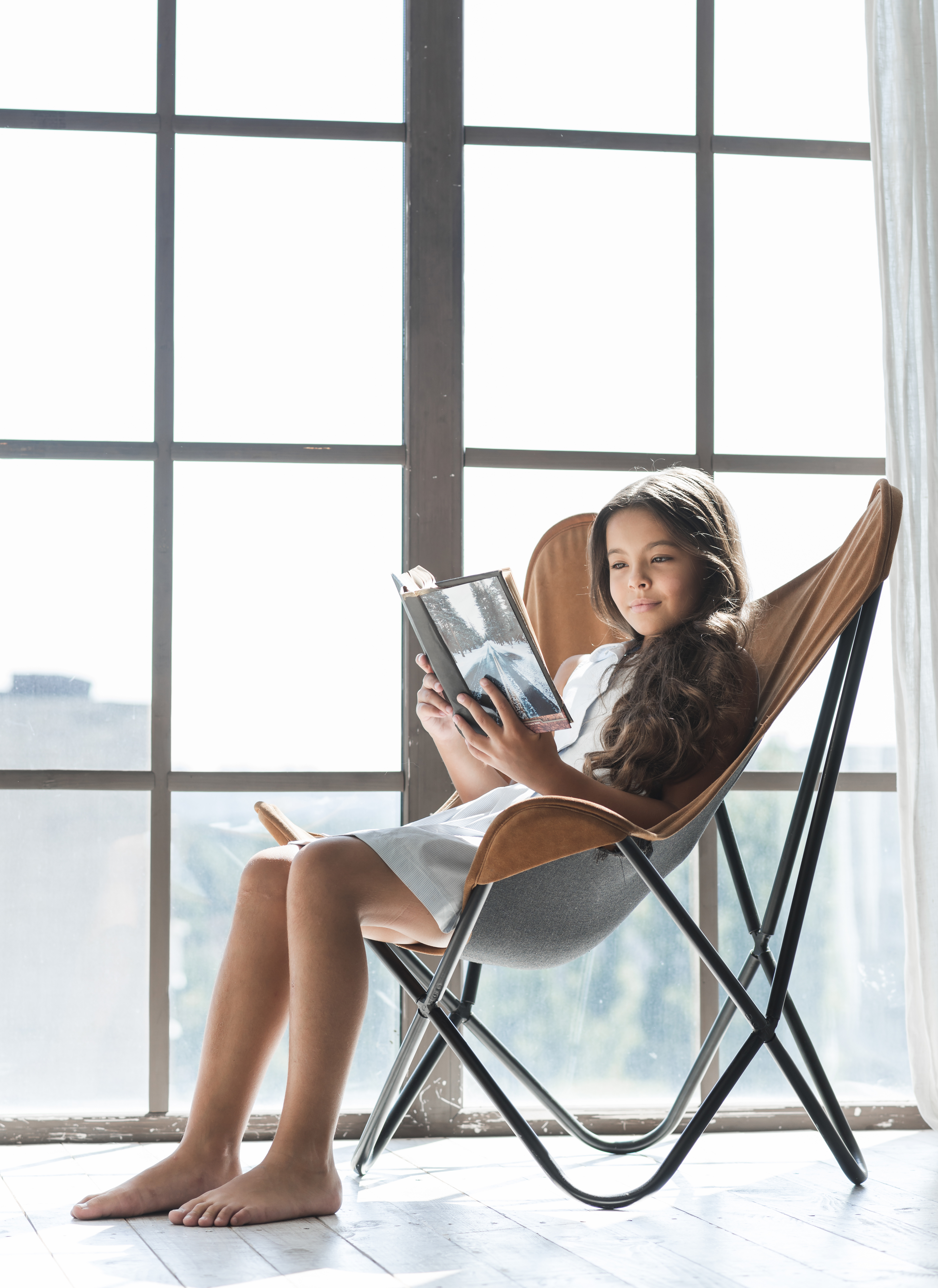Girl sitting reading a book.