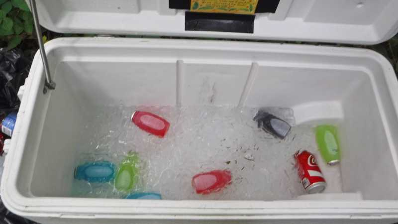 A cooler of soft drinks