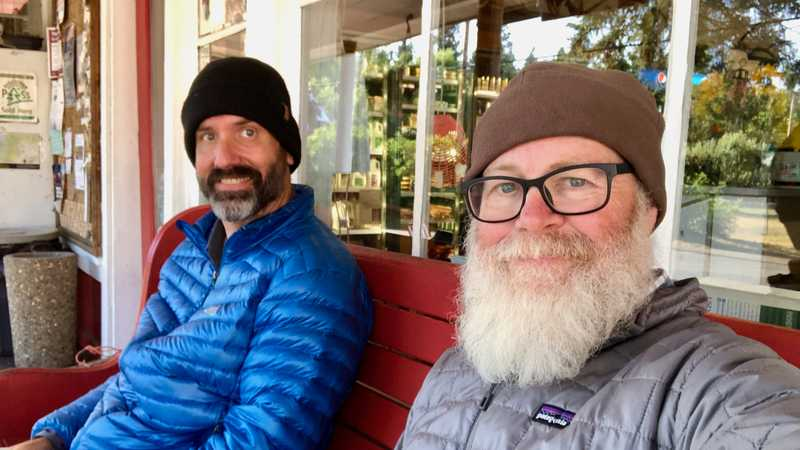 Dave and Gravity on the porch of Trout Lake General Store