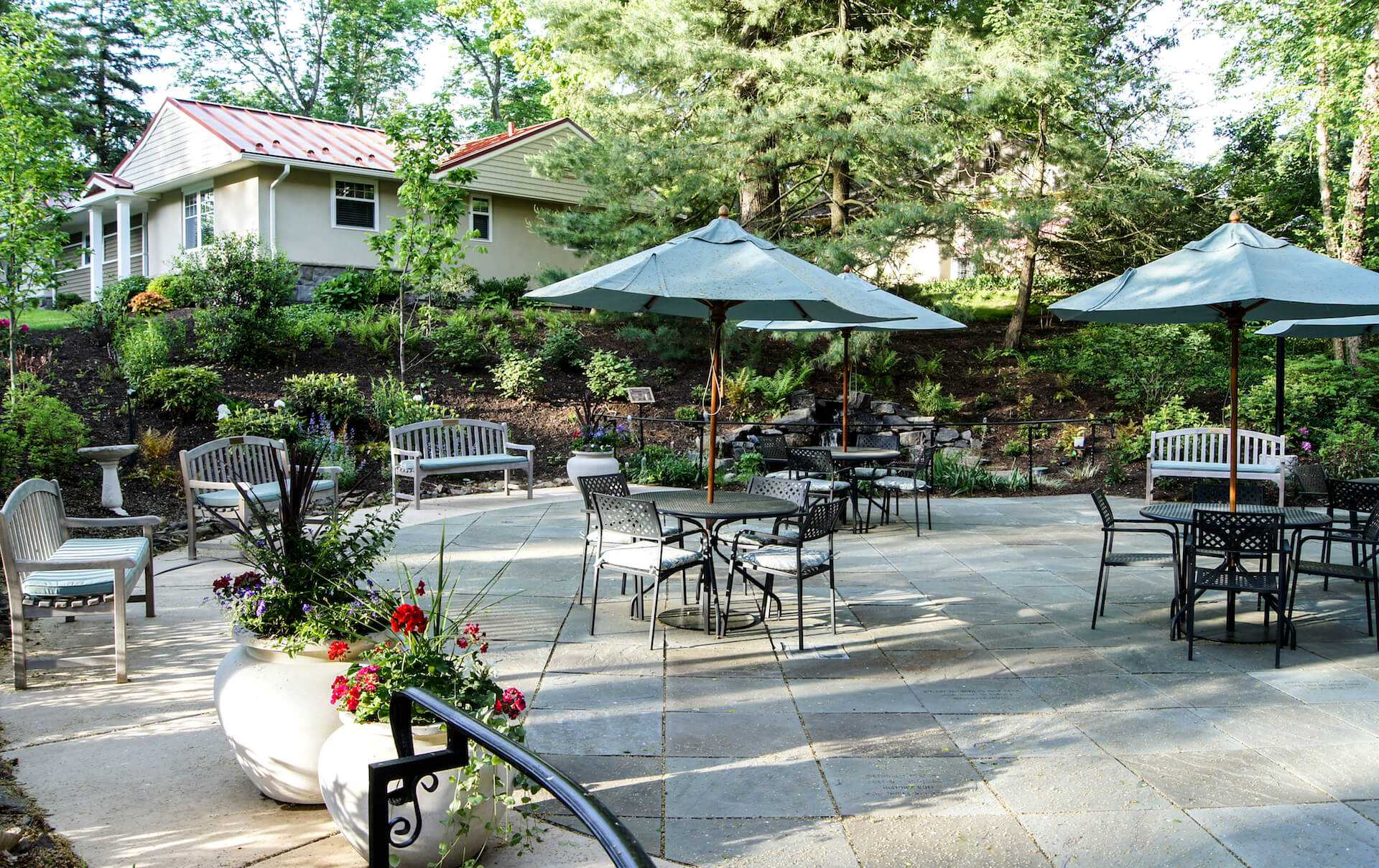 Rosemont outdoor dining area surrounded by landscaping
