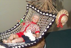 old lady doll in hammock close up