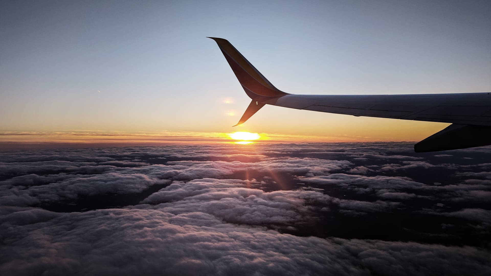 The sunset as seen from above the clouds.