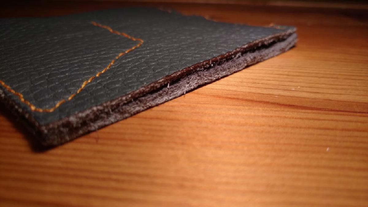 A close up picture of the opening of the finished coin wallet