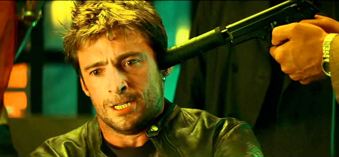 A picture of Hugh Jackman in Swordfish with a gun to his head.