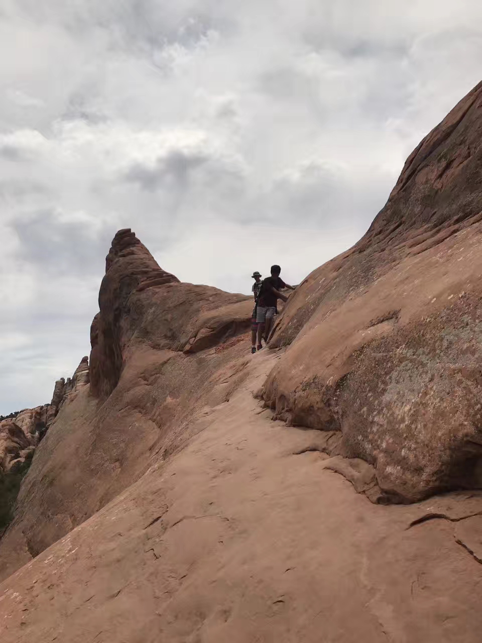 Me holding on to the rocks while getting over an almost vertical cliff