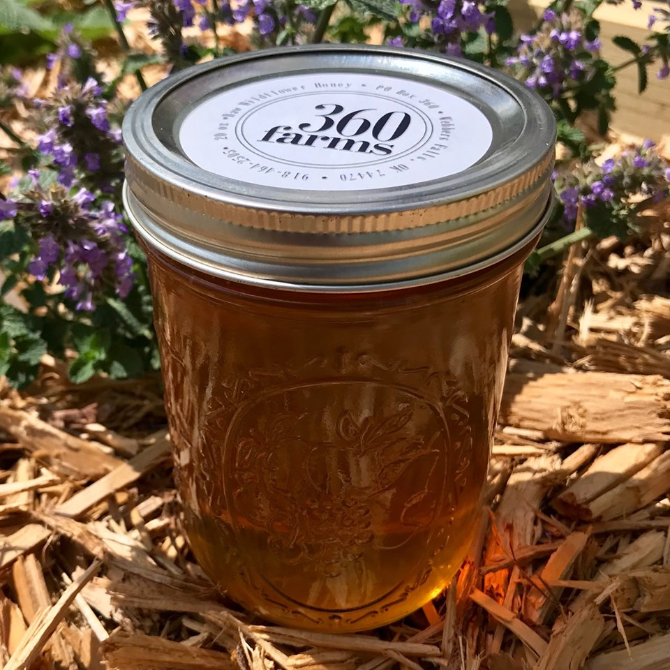 Elderberry honey packaged with the 360 Farms logo