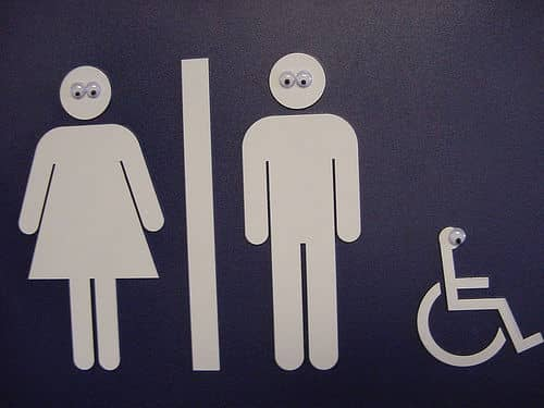restroom sign with googly eyes