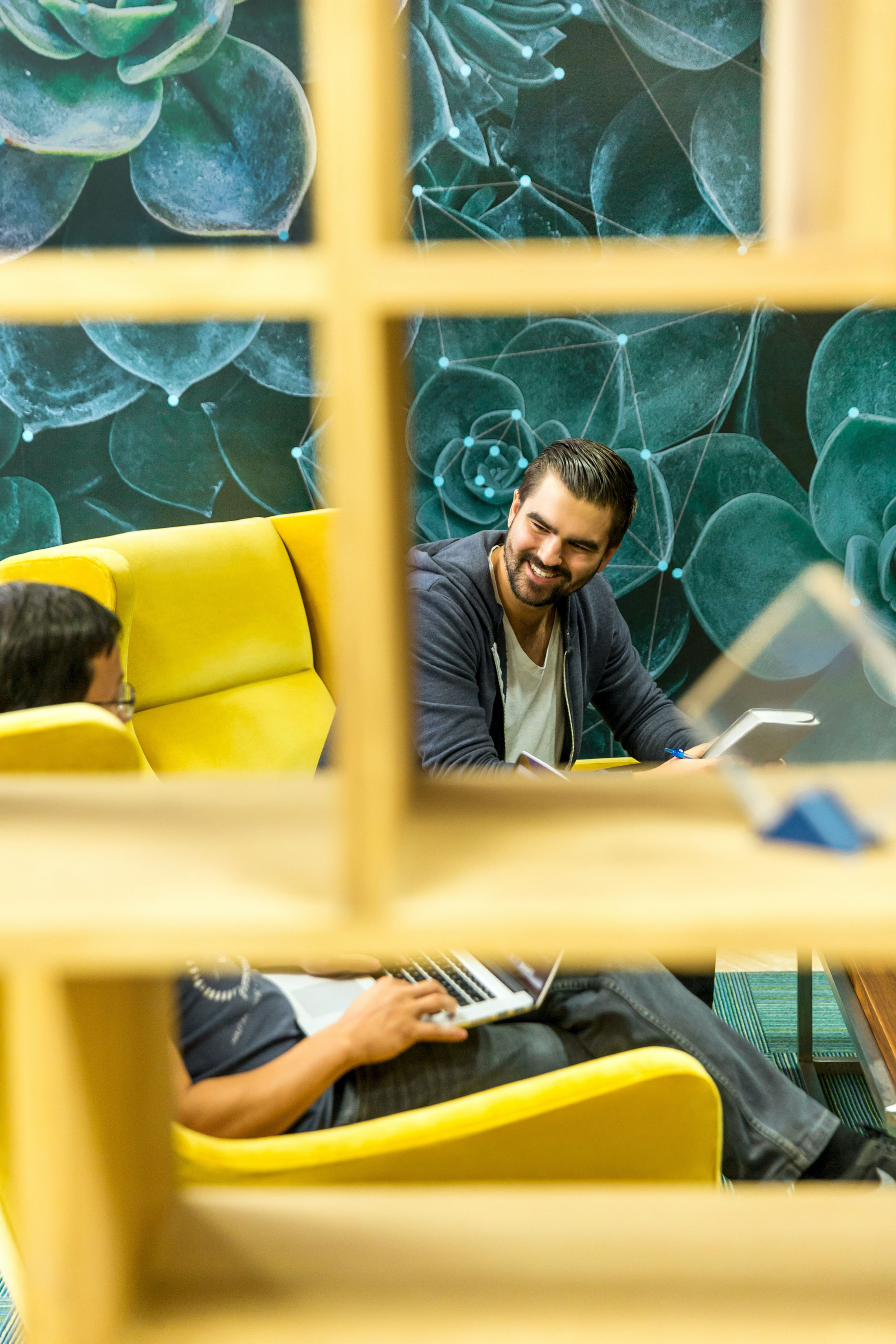 professional man working in open space office smiling laughing positive experience