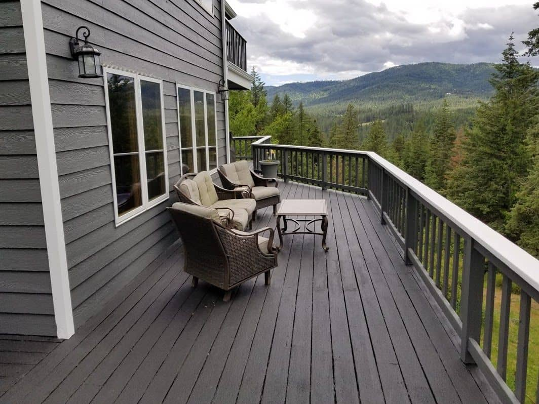 enlarged photo of dark stained deck in the mountains