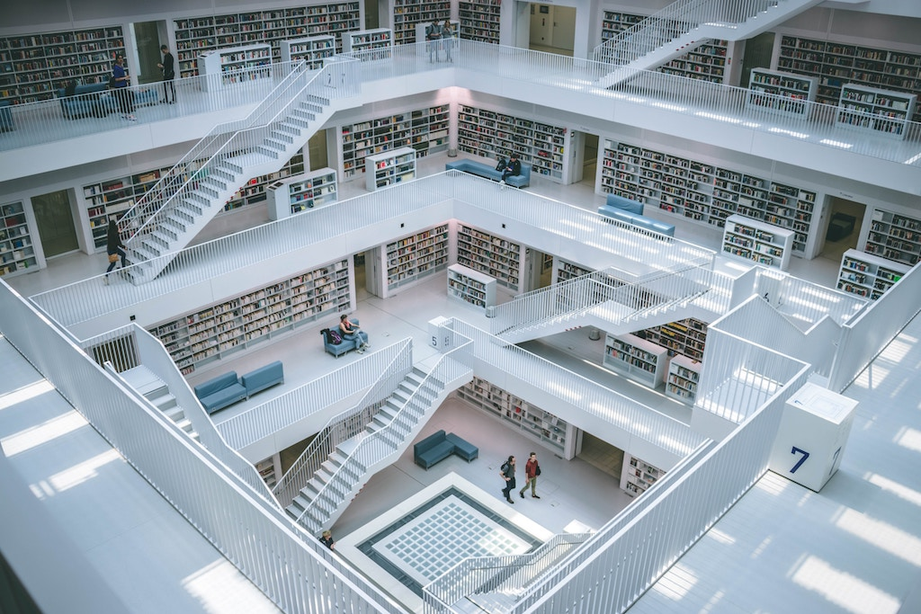 People walking in a library - Photo by Gabriel Sollmann on Unsplash
