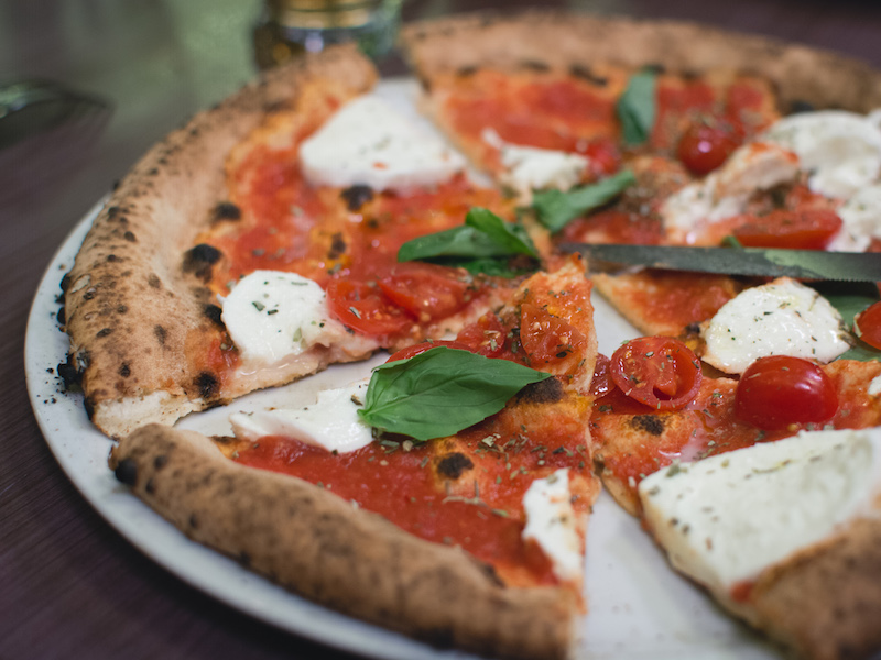 Simple italian pizza with cherry tomatoes